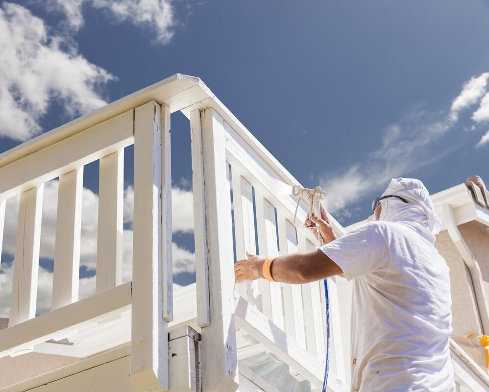 professional painter working on fence painting